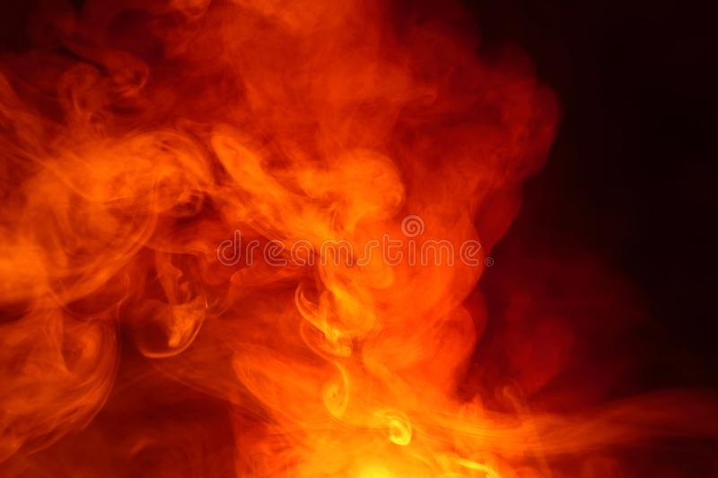 Imitation of bright flashes of orange-red flame. Background of abstract colored smoke. Imitation of bright flashes of orange-red flame. Background from abstract stock photography