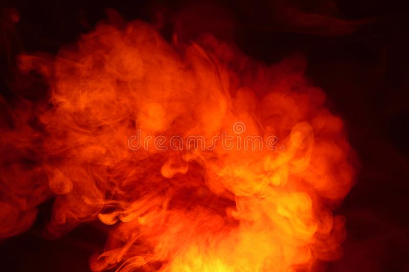 Imitation of bright flashes of orange-red flame. Background of abstract colored smoke. Imitation of bright flashes of orange-red flame. Background from abstract royalty free stock photography