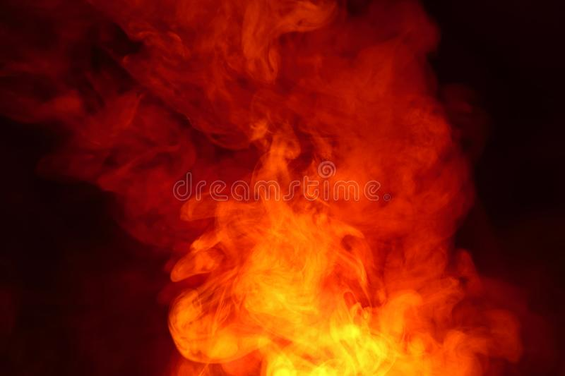 Imitation of bright flashes of orange-red flame. Background of abstract colored smoke. Imitation of bright flashes of orange-red flame. Background from abstract royalty free stock photo