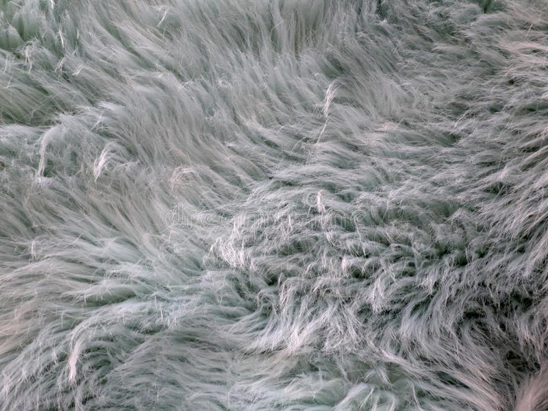 Imitation fur of bluish color with some and fluffiness royalty free stock photos