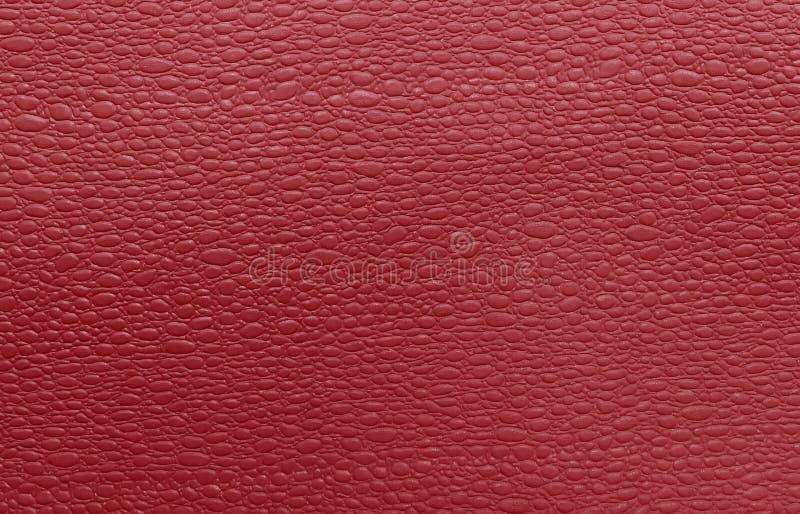 Imitazione della pelle di serpente rossa, struttura artificiale fotografia stock libera da diritti