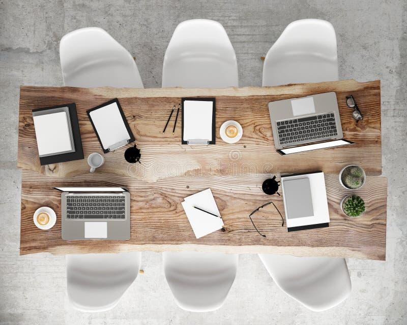 Imite encima de la mesa de reuniones de la reunión con los accesorios y los ordenadores portátiles, fondo interior de la oficina  imagen de archivo libre de regalías