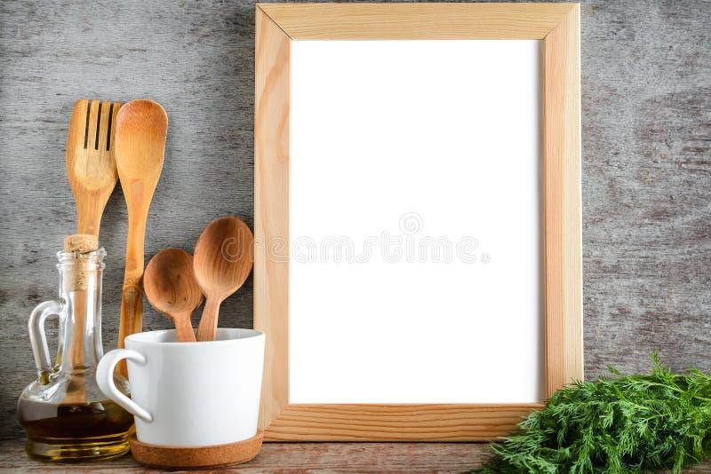 Imite encima del utensilio de la foto del marco y del aceite de oliva en sitio de la cocina imagenes de archivo