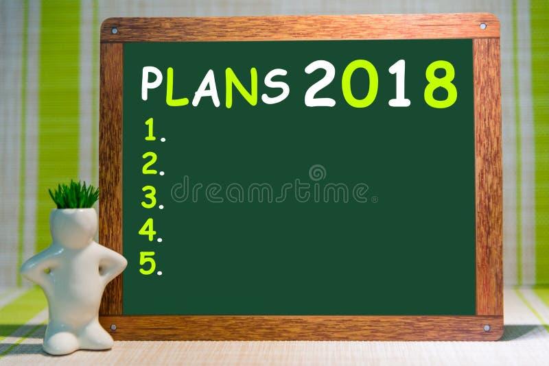 Imite para arriba, en fondo de madera de los marcadores, y fondo para la inserción, 2018, nuevos yers felices, planes imágenes de archivo libres de regalías