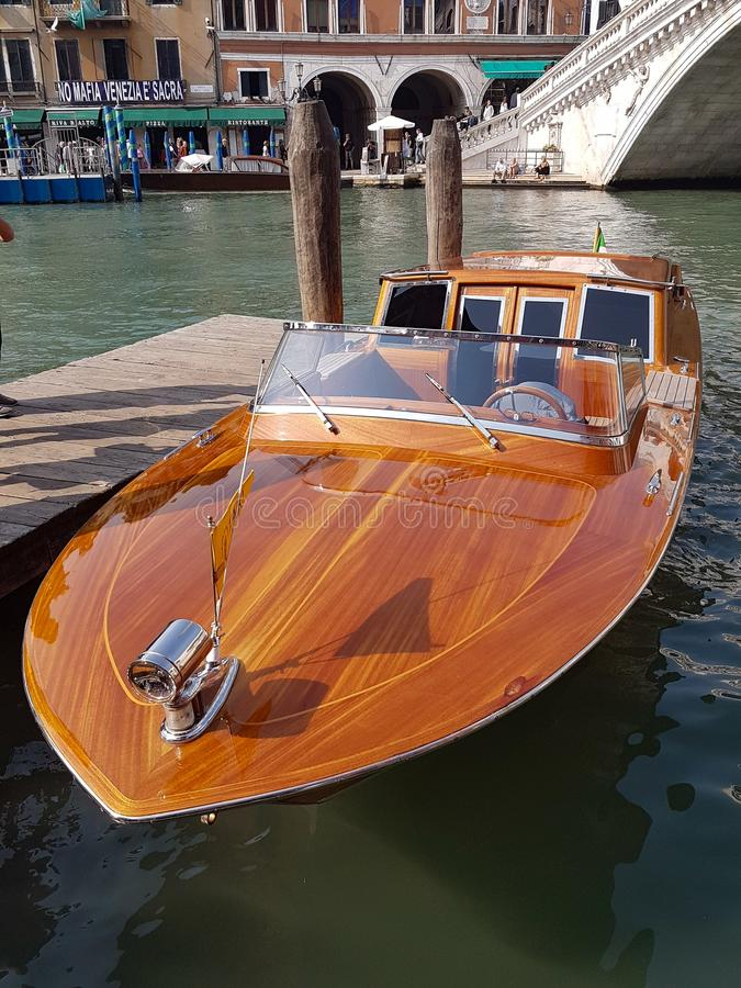 An immaculate Venetian Water Taxi moored at the Rialto Bridge. Venice stock photography