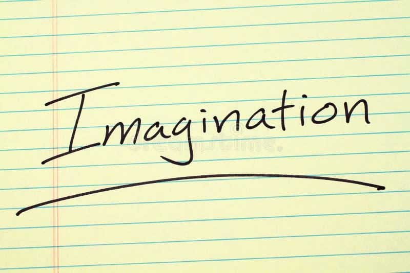 Immaginazione su un blocco note giallo immagini stock libere da diritti