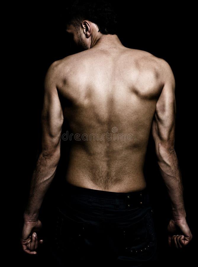 Immagine artistica del grunge dell'uomo con la parte posteriore muscolare fotografia stock libera da diritti