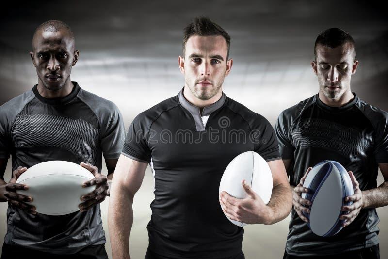 Immagine composita dei giocatori di rugby fotografia stock