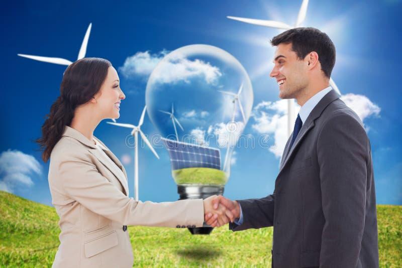 Immagine composita dei partner futuri che stringono le mani immagini stock libere da diritti