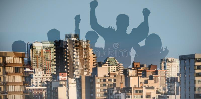 Immagine composita dei silhouetters che celebrano immagine stock libera da diritti