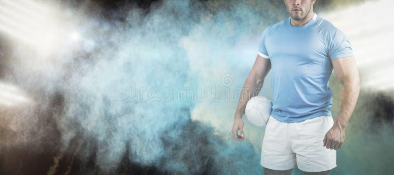 Immagine composita del giocatore di rugby che esamina macchina fotografica immagini stock libere da diritti