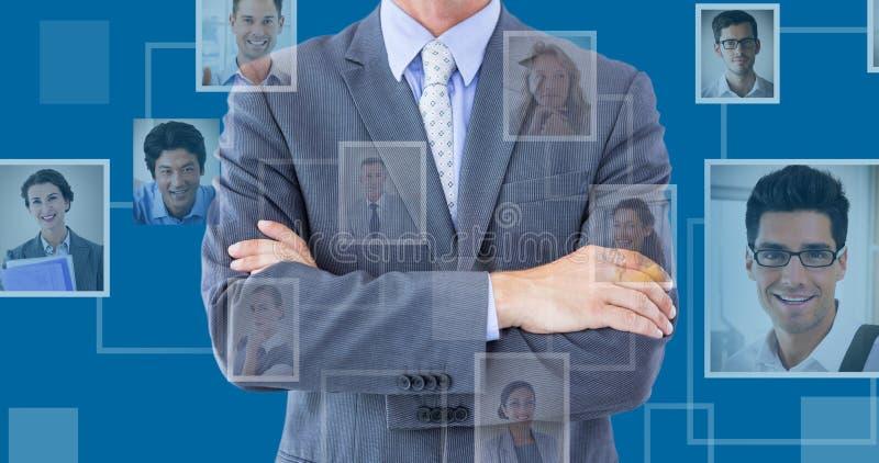 Immagine composita del midsection delle armi di condizione dell'uomo d'affari attraversate fotografie stock