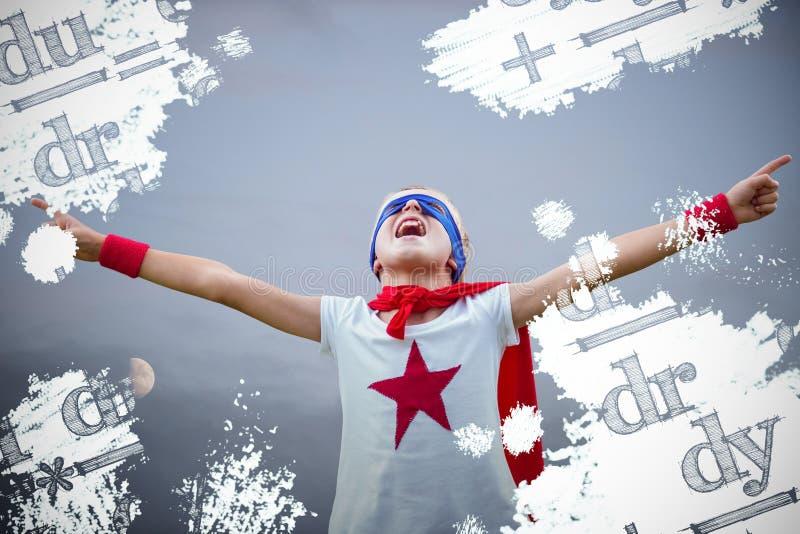 Immagine composita del ragazzino vestita come superman immagine stock libera da diritti