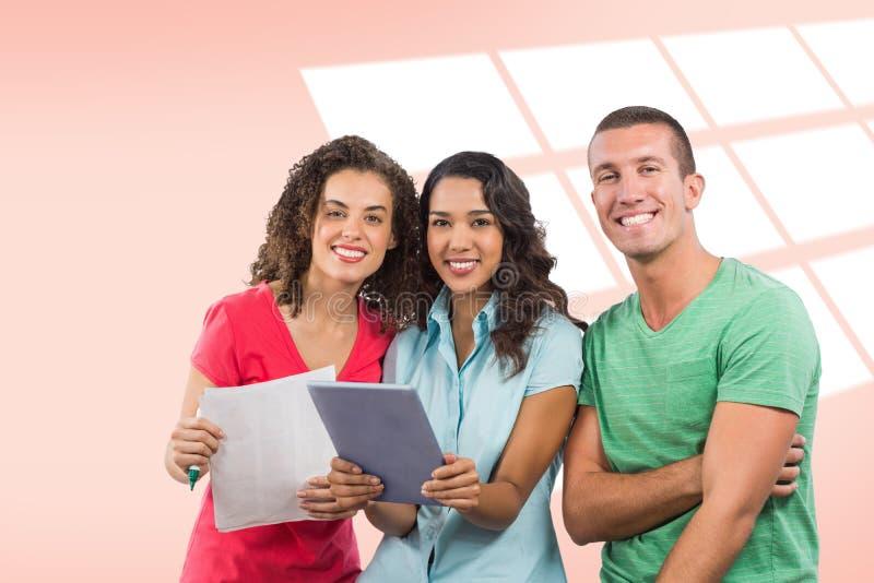 Immagine composita del ritratto della gente di affari creativa sorridente con la compressa digitale ed il documento fotografia stock