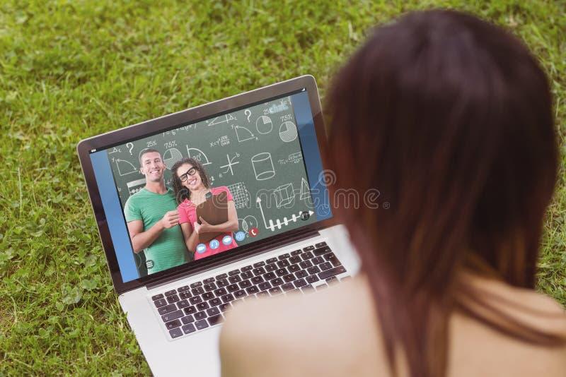 Immagine composita del ritratto della gente di affari sorridente con la lavagna per appunti immagine stock libera da diritti