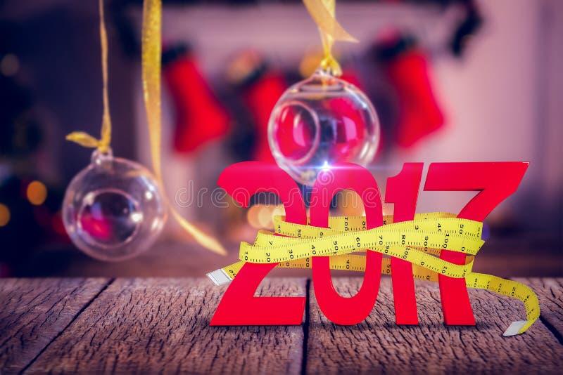 Immagine composita dell'immagine digitalmente generata del nuovo anno con la misura di nastro illustrazione di stock