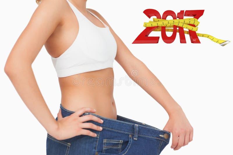 Immagine composita dell'immagine digitalmente generata del nuovo anno con la misura di nastro immagini stock