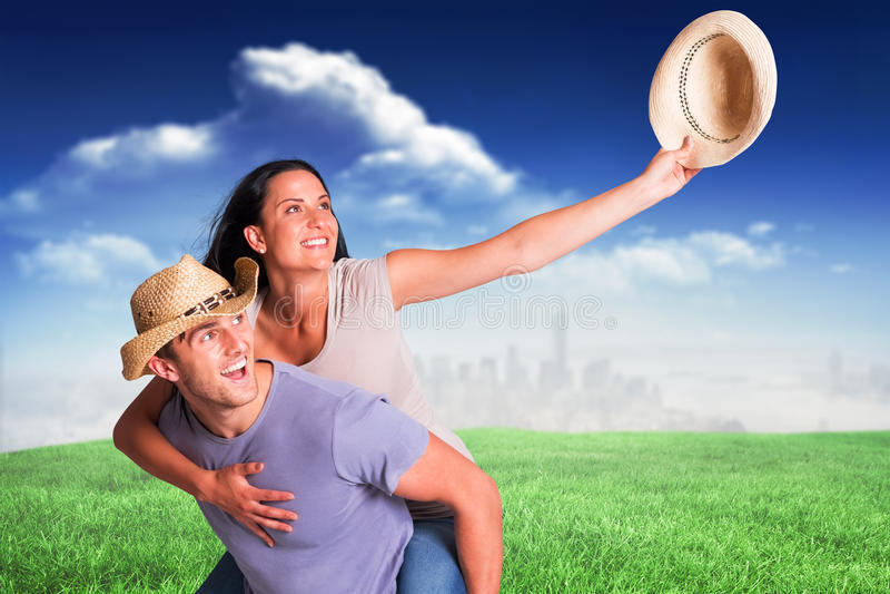 Immagine composita dell'uomo che dà alla sua amica graziosa un a due vie immagini stock libere da diritti