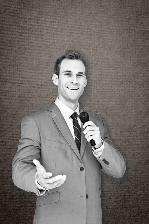 Immagine composita dell'uomo d'affari che dà discorso fotografie stock libere da diritti