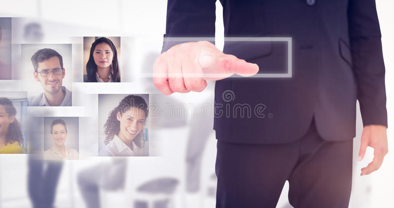 Immagine composita dell'uomo d'affari che indica con il dito fotografia stock libera da diritti