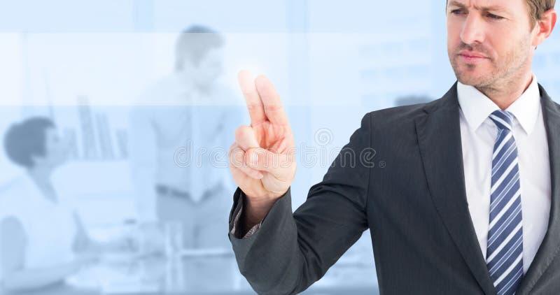 Immagine composita dell'uomo d'affari che indica con il suo dito fotografia stock