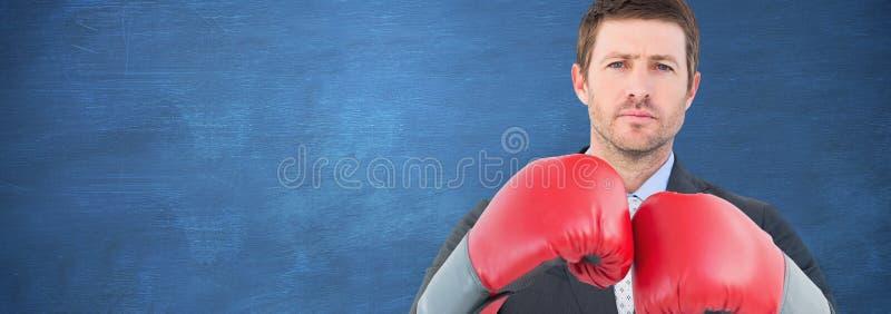 Immagine composita dell'uomo d'affari con i guantoni da pugile fotografie stock libere da diritti