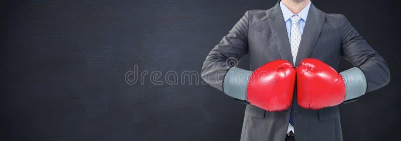 Immagine composita dell'uomo d'affari con i guantoni da pugile fotografia stock libera da diritti
