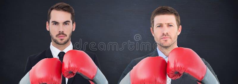 Immagine composita dell'uomo d'affari con i guantoni da pugile fotografie stock