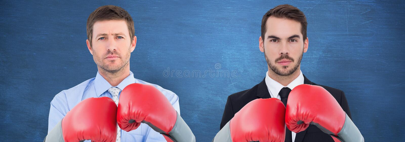 Immagine composita dell'uomo d'affari con i guantoni da pugile immagine stock libera da diritti