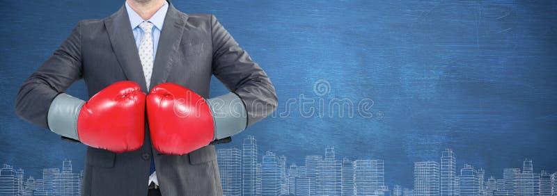 Immagine composita dell'uomo d'affari con i guantoni da pugile immagine stock