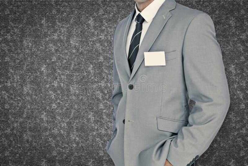 Immagine composita dell'uomo d'affari con il distintivo immagine stock libera da diritti