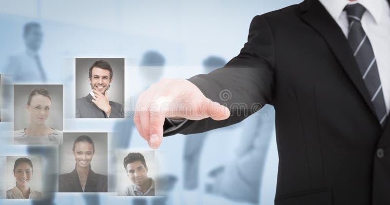 Immagine composita dell'uomo d'affari in vestito che indica il suo dito immagine stock libera da diritti