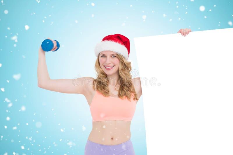 Immagine composita della bionda festiva di misura che sorride al manifesto della tenuta della macchina fotografica fotografie stock