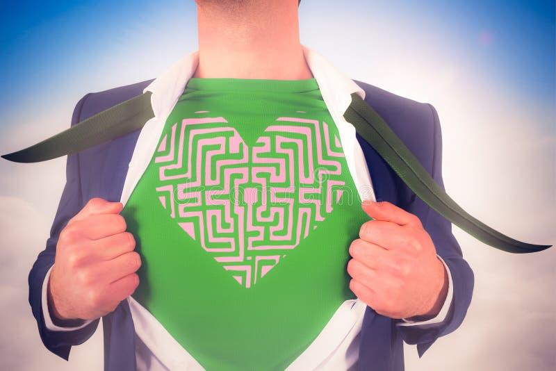 Immagine composita della camicia di apertura dell'uomo d'affari nello stile del supereroe fotografie stock libere da diritti