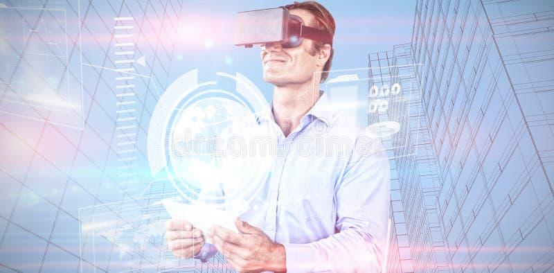 Immagine composita della compressa della tenuta dell'uomo d'affari mentre indossando i vetri del vr fotografie stock