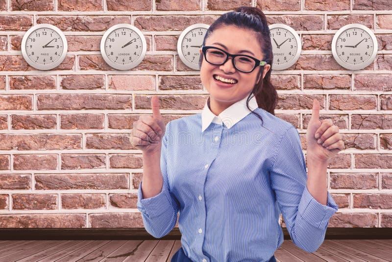 Immagine composita della donna di affari asiatica sorridente che mostra i pollici su immagini stock