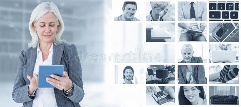 Immagine composita della donna di affari sicura che per mezzo della compressa digitale fotografia stock libera da diritti