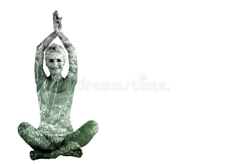 Immagine composita della donna sportiva che si siede nella posa namaskar con le mani torte fotografia stock libera da diritti