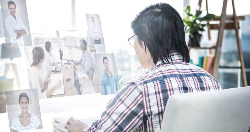 Immagine composita della gente di affari che ha una riunione fotografie stock libere da diritti