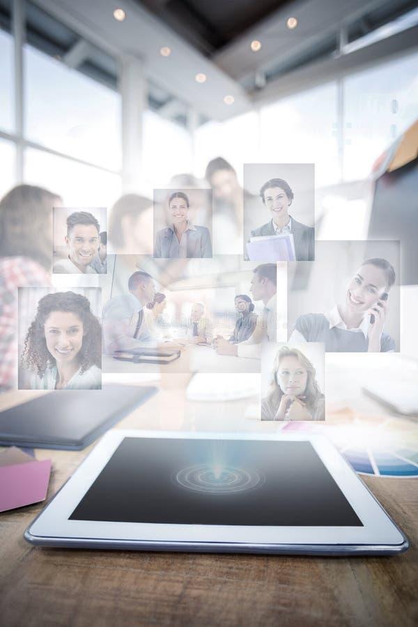 Immagine composita della gente di affari che ha una riunione immagini stock