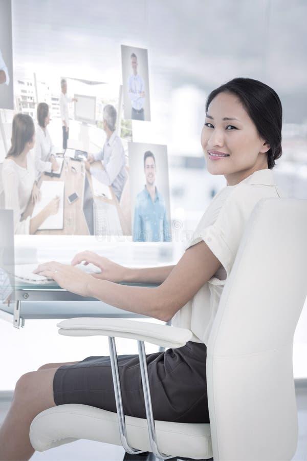 Immagine composita della gente di affari che ha una riunione fotografia stock