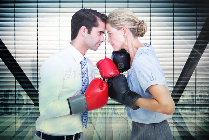 Immagine composita della gente di affari che indossa e che inscatola i guanti rossi immagine stock