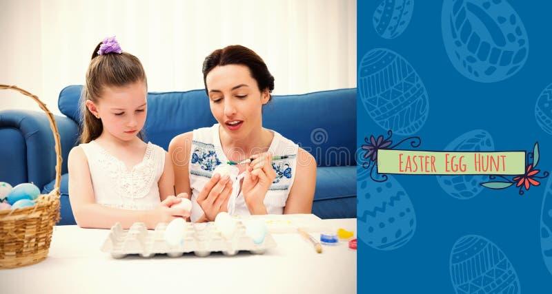 Immagine composita della madre e della figlia che dipingono le uova di Pasqua fotografia stock
