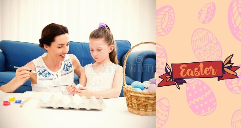 Immagine composita della madre e della figlia che dipingono le uova di Pasqua fotografie stock libere da diritti