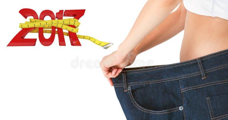 Immagine composita della pancia della donna in pantaloni troppo grandi immagine stock libera da diritti