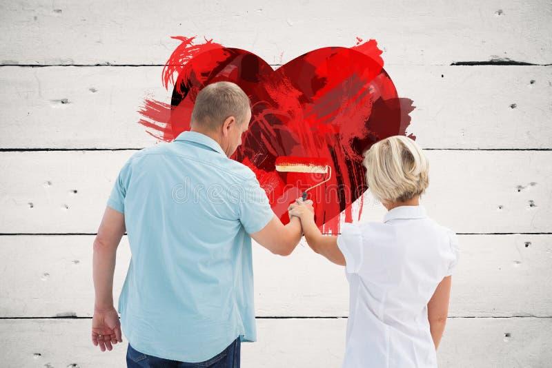 Immagine composita della parete bianca di verniciatura delle più vecchie coppie felici immagini stock libere da diritti