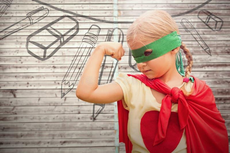 Immagine composita della ragazza in capo rosso che mostra i muscoli fotografie stock