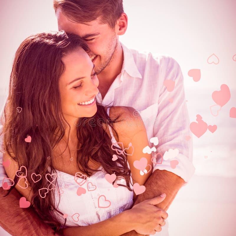 Immagine composita delle coppie attraenti che stringono a sé immagini stock