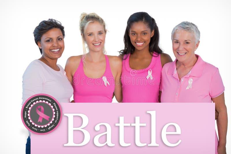 Immagine composita delle donne sorridenti che indossano le cime ed i nastri rosa del cancro al seno immagini stock libere da diritti