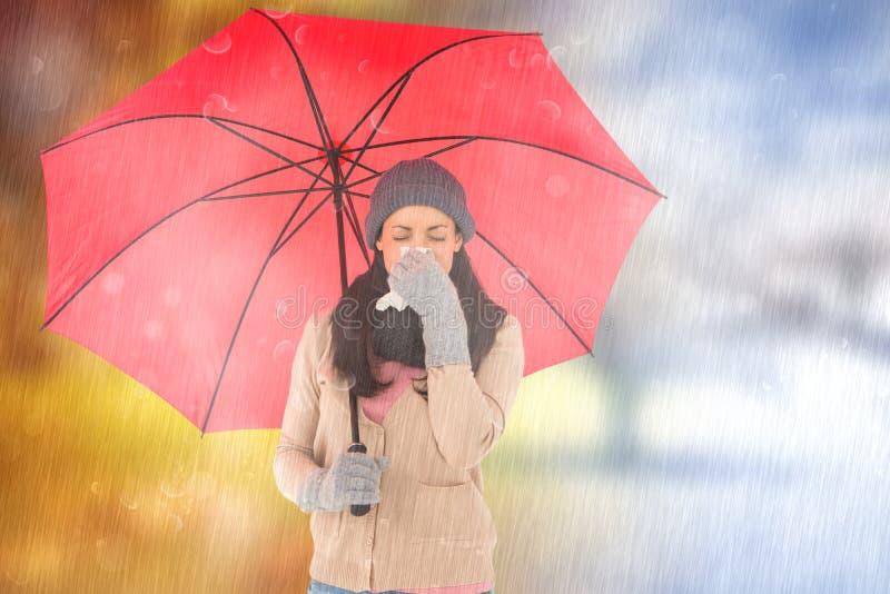 Immagine composita di castana malato soffiando il suo naso mentre tenendo un ombrello immagine stock libera da diritti